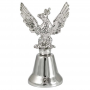 Pequena campana de metal con águila