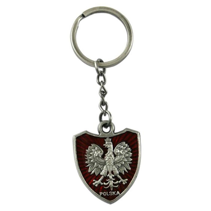 Llavero águila de metal en el escudo