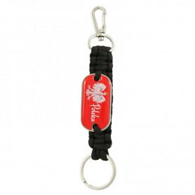 Un porte-clés chaîne avec un badge Pologne